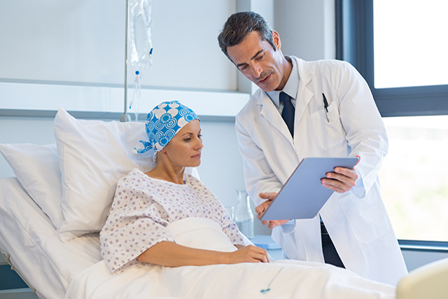 Reviewing test results with a patient with cancer.
