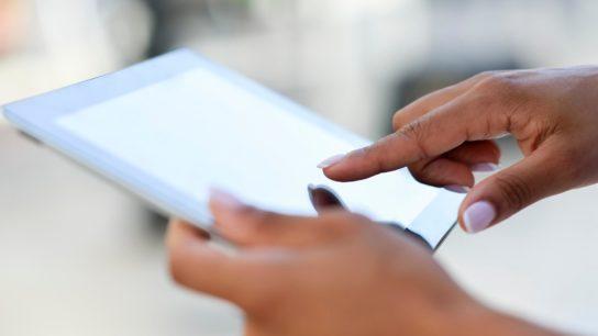 Closeup of a person using a digital tablet.