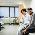 A doctor discusses test results with a patient in her office.