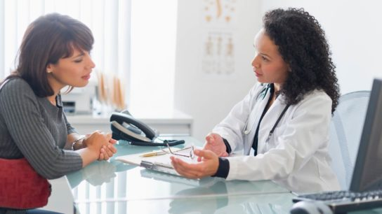 A doctor and patient discuss an issue.