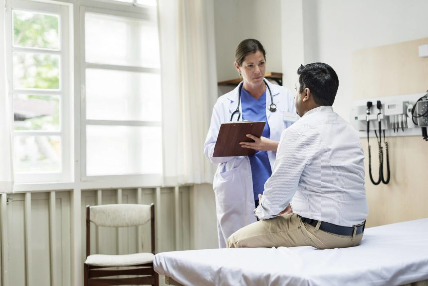 A doctor checks on a patient.