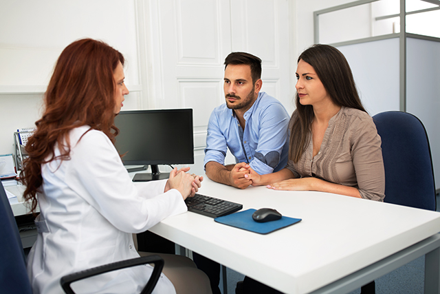 A family discusses fertility options with a clinician.