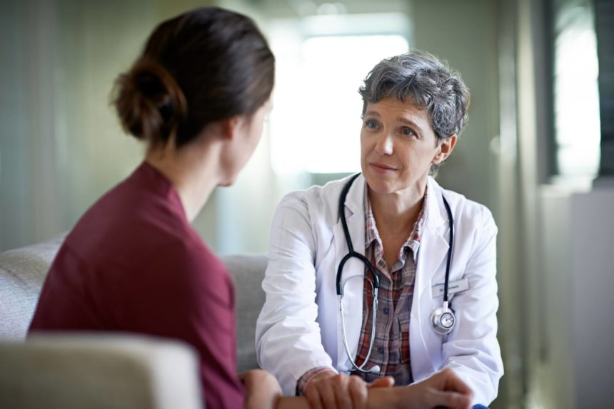 A woman speaks with her doctor.