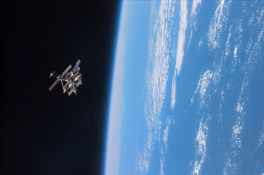 The Mir space station orbiting the Earth.