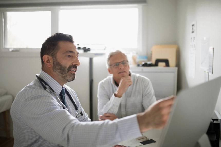 Physician discussing chart with patient