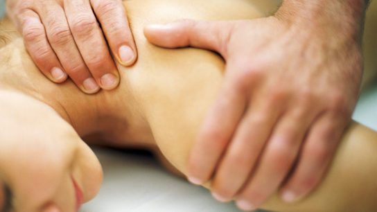 A patient with cancer receives integrative therapy.