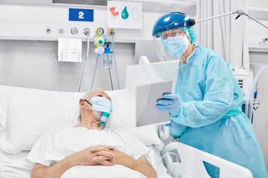Doctor Showing Digital Tablet To Patient in ICU
