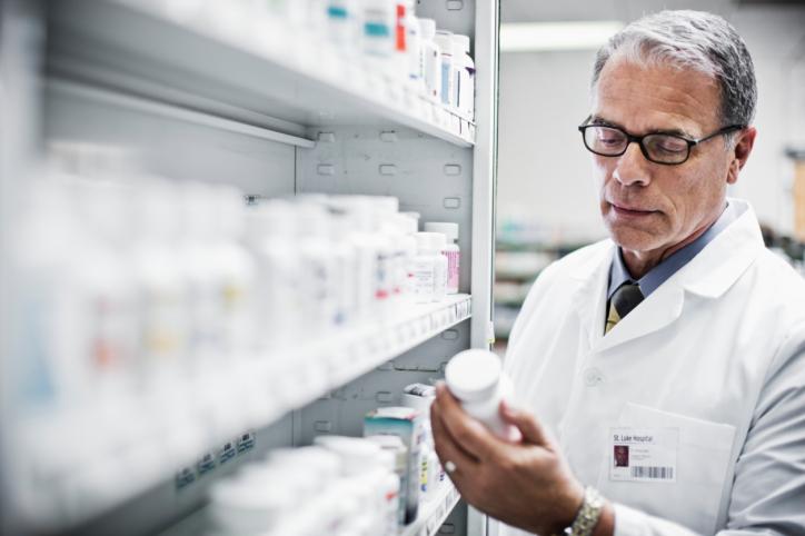 Pharmacist holding drug